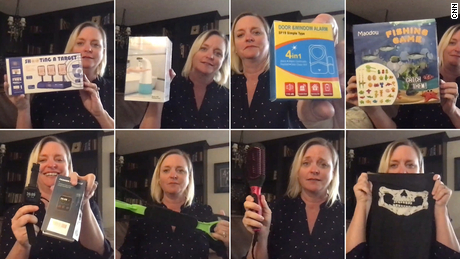 Jen Blinn holds up some of the unusual items she received in Amazon packages. She didn't order these goods and doesn't know who sent them to her.