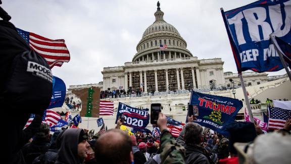 WASHINGTON, DC - JANUARY 06: Pro-Trump supporters storm the U.S. Capitol following a rally with President Donald Trump on January 6, 2021 in Washington, DC. Trump supporters gathered in the nation