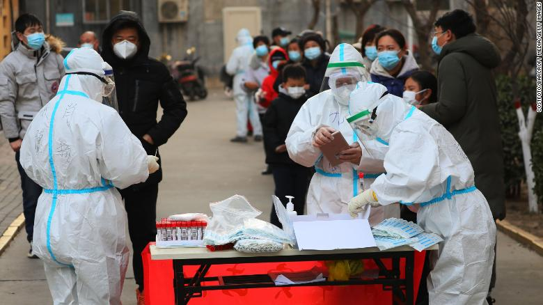 Citizens line up for the third round of testing in Shijiazhuang on January 18.