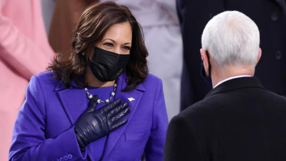 WASHINGTON, DC - JANUARY 20: U.S. Vice President-elect Kamala Harris greets Vice President Mike Pence as she arrives to the inauguration of U.S. President-elect Joe Biden on the West Front of the U.S. Capitol on January 20, 2021 in Washington, DC.  During today