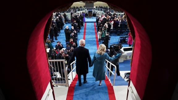 The Bidens walk out for the inauguration on Wednesday.