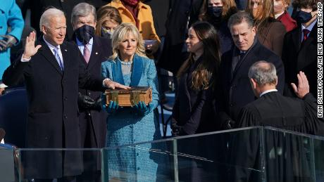 Joe Biden is sworn in as the 46th president of the United States by Chief Justice John Roberts as Jill Biden holds the Bible during the 59th Presidential Inauguration at the U.S. Capitol in Washington, Wednesday, Jan. 20, 2021.(Erin Schaff/The New York Times via AP, Pool)
