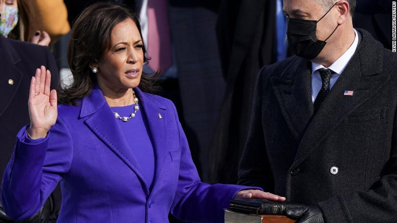 Kamala Harris is sworn in as vice president as her husband, Doug Emhoff, holds the Bible.