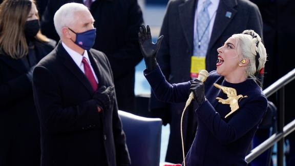 Lady Gaga sings the National Anthem in front of Vice President Mike Pence before Harris and Biden were sworn in.
