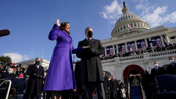 Harris is sworn in as vice president as her husband holds the Bible. Harris was sworn in by Supreme Court Justice Sonia Sotomayor. She wore the color purple as a nod to Shirley Chisholm, the first African-American woman to run for president.