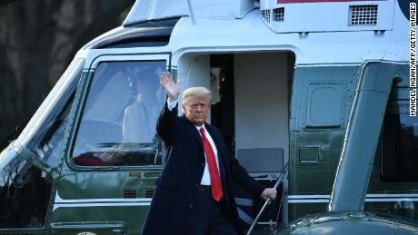 Trump waves as he boards Marine One.