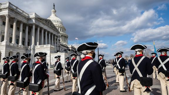 """Historical military attire is worn for the """"pass in review,"""" a tradition where the incoming president reviews a procession of military troops."""