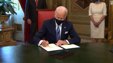 Watch President Biden sign first 3 proclamations