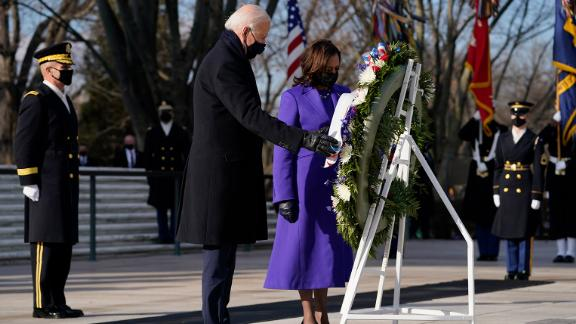 Biden and Harris participate in a wreath-laying ceremony at the Tomb of the Unknown Soldier in Arlington, Virginia