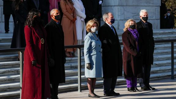 Three former US presidents and first ladies wait for President Biden during the wreath-laying ceremony at the Tomb of the Unknown Soldier. From left are Michelle Obama, Barack Obama, Laura Bush, George W. Bush, Hillary Clinton and Bill Clinton.