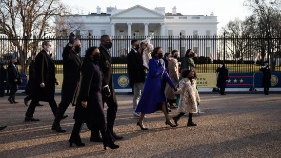 Vice President Kamala Harris walks with her family to the White House.