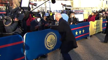 Biden fist bumps members of the media during inaugural parade