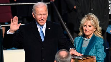 Joe Biden as the 46th President of the United States is sworn in by Chief Justice John Roberts as Jill Biden holds the Bible.
