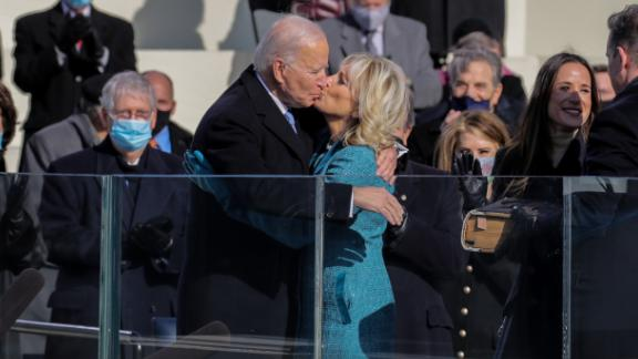 The Bidens kiss at the inauguration ceremony.