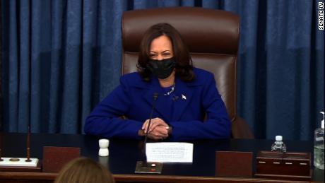 A proud Harris smiles as she swears in new senators in her new role
