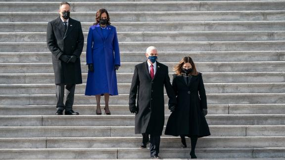 Pence and his wife, Karen, are trailed by his successor, Kamala Harris, and her husband, Doug Emhoff, after the inauguration in January 2021.