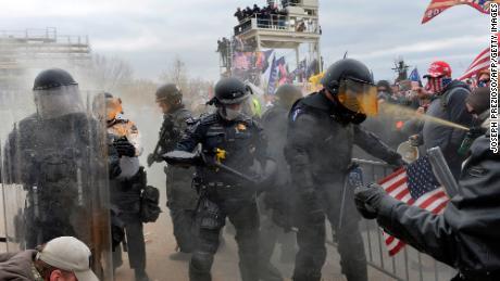 Trump supporters clash with police and security forces as they try to storm the US Capitol in Washington, DC on January 6, 2021