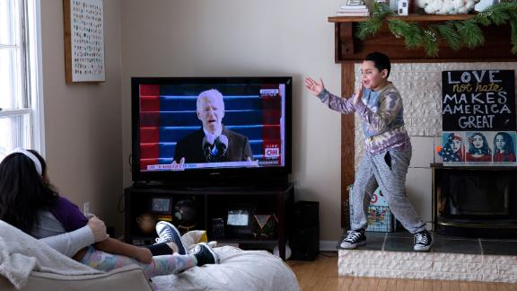 Jackson Smith cheers as he watches the inauguration with his family at their home in Beverly Hills, Michigan.