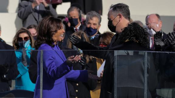 Harris smiles at her husband during her swearing-in.