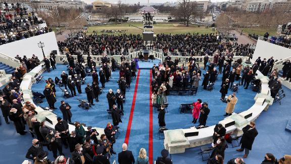 The Bidens walk out on stage for the inauguration.
