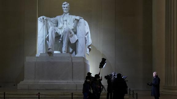 """Biden delivers remarks from the Lincoln Memorial during the prime-time """"Celebrating America"""" event on Wednesday night. """"It is humbling to stand here in this place in front of these sacred words,"""" Biden said during the live television broadcast. """"Humbling out of respect to President Lincoln and the office we now share and humbling because of you, the American people."""""""