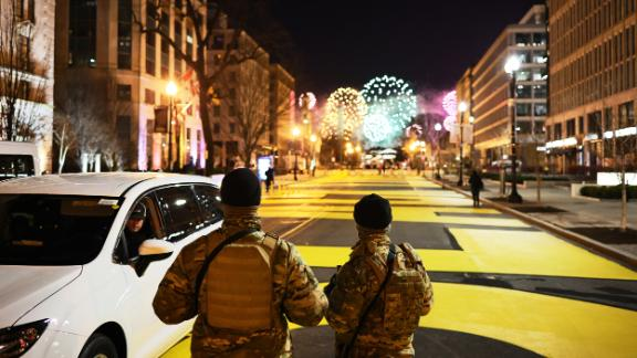 National Guard members watch the fireworks from Black Lives Matter Plaza.