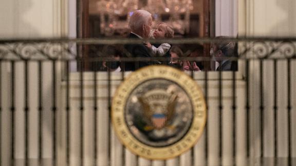 Biden holds his grandson Beau inside the White House.
