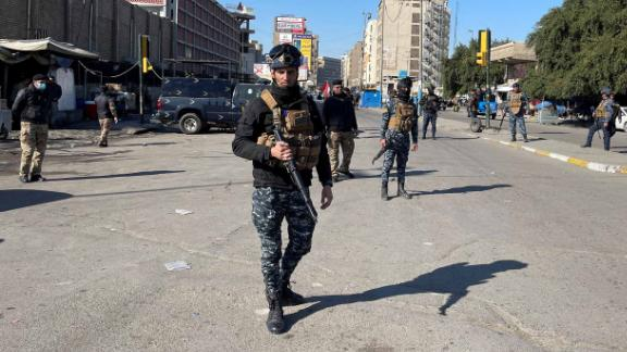Iraqi security forces keep guard the site of a suicide attack in Baghdad, Iraq January 21, 2021. REUTERS/Thaier al-Sudani