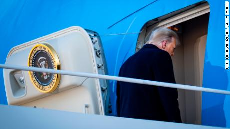 Trump boards Air Force One at Joint Base Andrews.