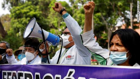 Health workers protest while going on an indefinite strike as they demand a better national health budget and access to vaccines, in Lima, Peru on January 13.