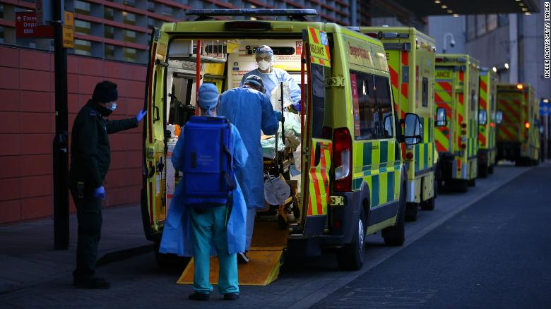 A patient is transported out of an ambulance by medics at the Royal London Hospital on January 2, 2021 in London, England.