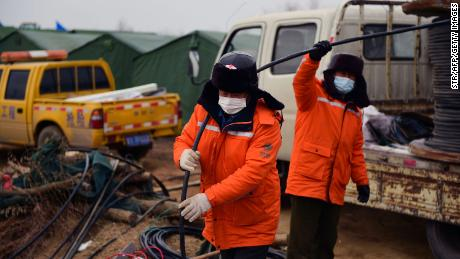 Members of a rescue team work at the site of a gold mine explosion where 22 miners are trapped underground in Qixia, in eastern China's Shandong province, on January 20, 2021.