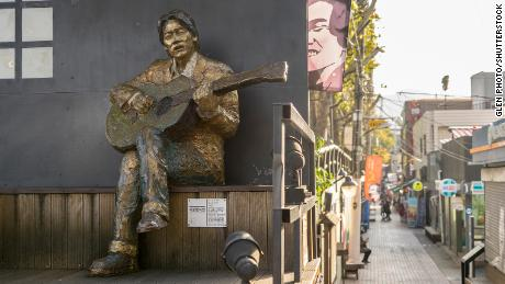 Tourists can visit a street dedicated to Kim Kwang-seok in the city of Daegu.