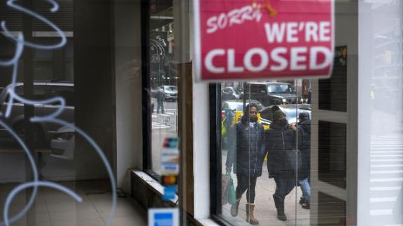 Mandatory Credit: Photo by JUSTIN LANE/EPA-EFE/Shutterstock (11700603g) Pedestrians walk past a closed store in New York, New York, USA, on 08 January 2021. The United States' Bureau of Labor Statistics released data today showing that the US economy lost 140,000 jobs in December and that the unemployment rate is at 6.7 percent as businesses continue to struggle with the economic impact of the coronavirus pandemic. Coronavirus Economy Impact, New York, USA - 08 Jan 2021