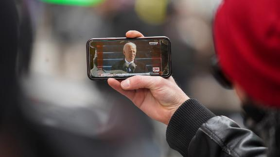 A man watches a live broadcast of the inauguration from Times Square in New York.