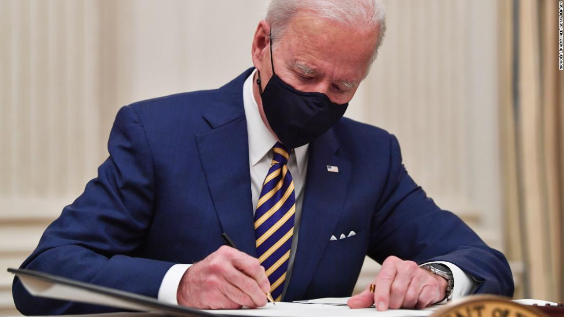 Biden signs executive order to promote $15 federal minimum wage - CNN Video