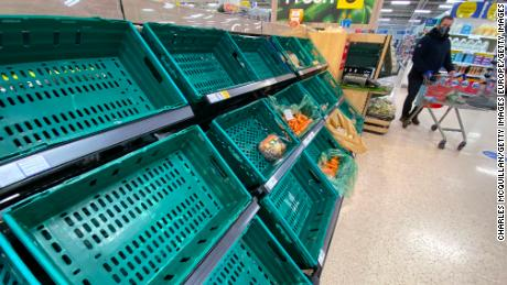 A supermarket customer looks at near empty shelves in a supermarket in Belfast, Northern Ireland earlier this month.
