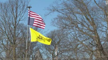 "An upside-down Stars and Strips and a ""Don't Tread on Me"" Gadsden flag suggest anti-government feeling in Woodstock, Ohio."