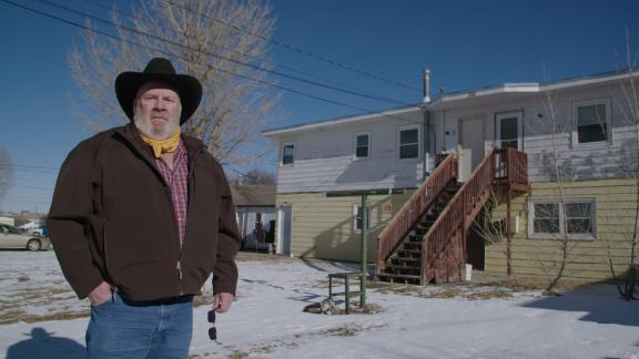 "Steve Gray stands outside his home in Gillette, Wyoming. He called CNN concerned that, following the election of President Biden, that Gillette could become a ""ghost town."" He says he was laid off from an oil field job in 2015, then subsequently from another job in oil and then one in coal last year."