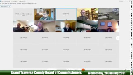Michigan county commissioner pulls gun out during virtual meeting when resident asked board to denounce Proud Boys
