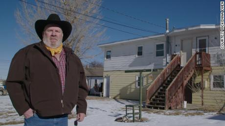 "Steve Gray stands outside his home in Gillette, Wyoming. After the election, he called CNN concerned that his city could become a ""ghost town."" He says he was laid off from an oil field job in 2015, then subsequently from another job in oil and then one in coal last year."