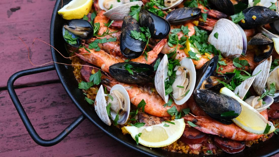 Paella with mussels and clams is a powerhouse dish that offers vitamin B12 to help you feel more even-keeled.