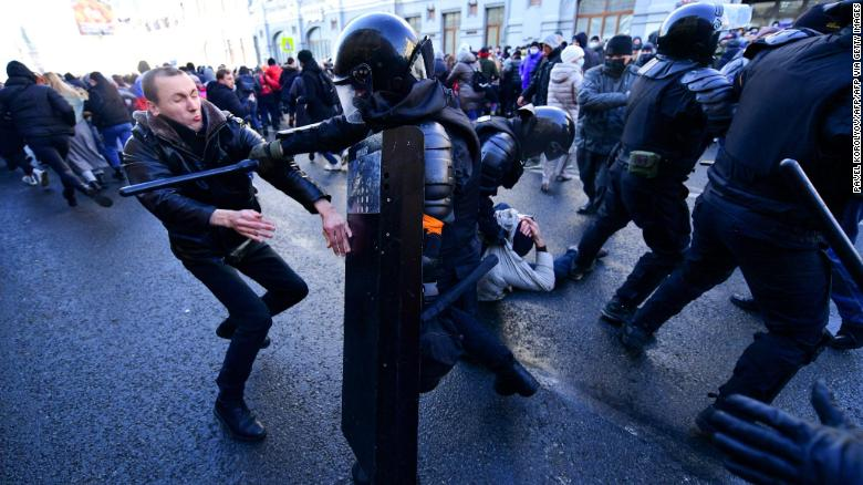 Demonstrators clash with riot police during a rally in Vladivostok on January 23, 2021.