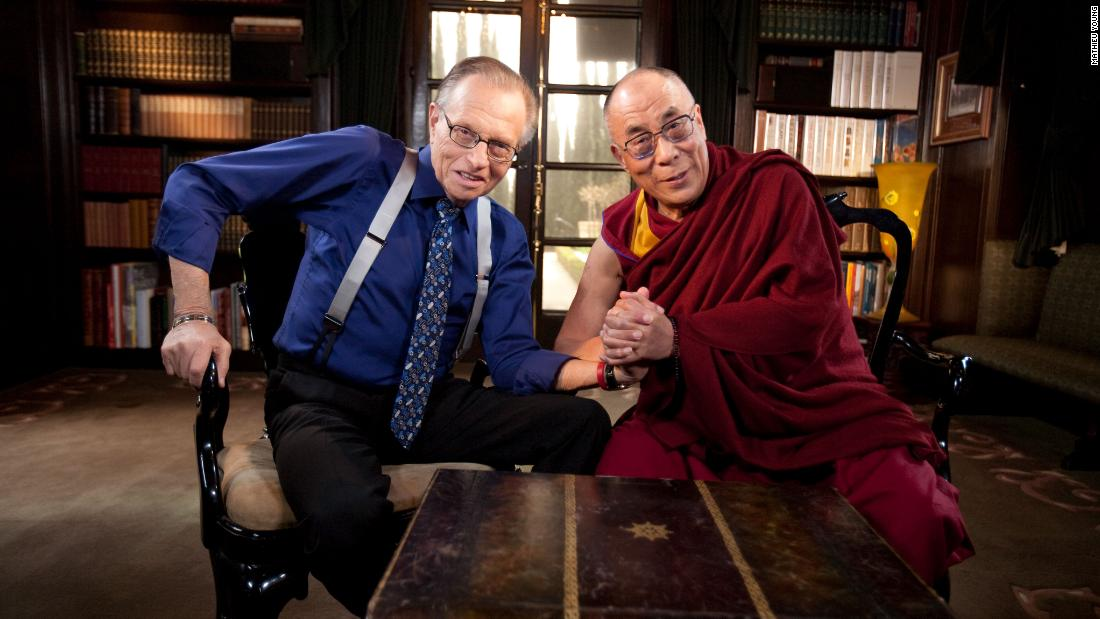 "King poses for a photo with the Dalai Lama during an interview for ""Larry King Live"" in 2010."