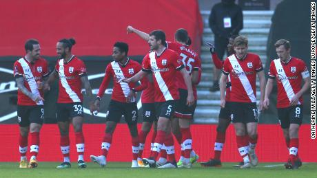 Southampton players celebrate taking the lead against Arsenal.
