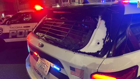 Officials said Tacoma police officers drive through the crowd, injuring at least one person