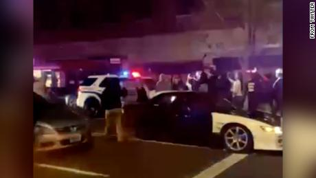 An image from the video of the incident still shows people around the vehicle.
