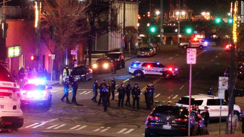 Protesters gather in Tacoma as an officer who drove into a crowd is placed on administrative leave