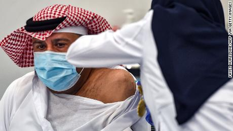 The first Saudi citizen receiving the Pfizer-BioNTech coronavirus vaccine in Riyadh in December 2020.