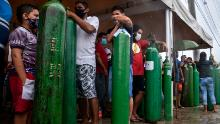 Relatives of patients infected with Covid-19 queue for long hours to refill their oxygen tanks at the Carboxi company in Manaus, Amazonas state, Brazil, on January 19, 2021.